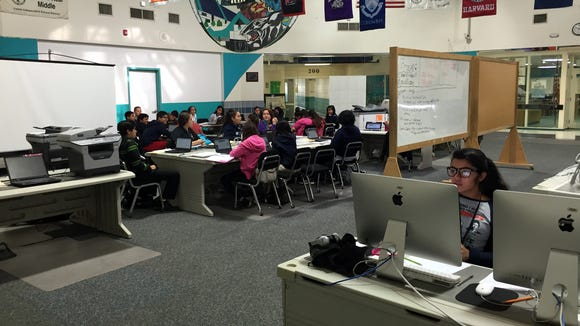 Students in a social studies class research Texas independence figures, background, while students in a math class work on a project, foreground, at Camino Real Middle School on Nov. 2.