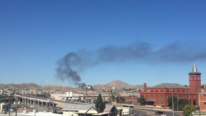 Large plumes of black smoke can be seen from a fire in Juarez.