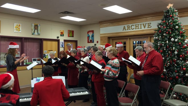 The ENMU-Ruidoso Community Choir, directed by Melba Valdez, sings Thursday at the Ruidoso Library, a sneak preview of the concert of sacred and classical seasonal music it will give Sunday at First Christian Church.