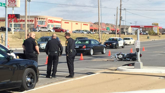 Police say two people were hospitalized Sunday following a crash at Republic Road and Golden Avenue.