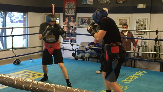 Tristan Harriman, left, and Zach Smith spar last week at the Nevada boxing club gym