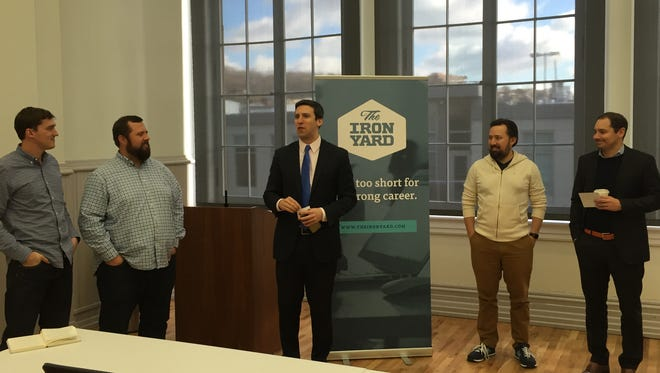 City of Cincinnati Council Member P.G. Sittenfeld introduces The Iron Yard, a nationally-recognized coding school opening a campus downtown, at a press conference Tuesday.