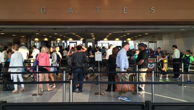 Passengers navigate security lines at Detroit Metro Airport's North Terminal at 7:30 a.m. Wednesday, May 25.
