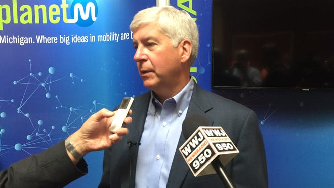 Governor Rick Snyder speaks to reporters at the Management Briefing Seminars in Traverse City