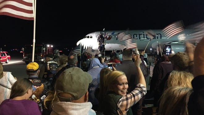Hundreds of people gathered at the Purdue Airport on Oct. 19, 2015, to welcome home 85 veterans on the Honor Flight.