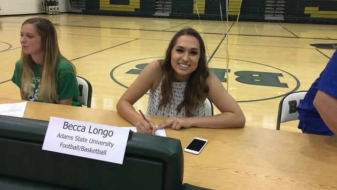 Chandler Basha kicker Becca Longo signs her letter of intent to play college football at Adams State.