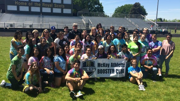 McKay students celebrate breaking ground for the new artificial turf project Tuesday.