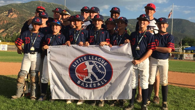 Dixie's U-12 baseball team is all smiles as it poses for a picture after capturing a West Region berth to represent the state in San Bernardino, California.