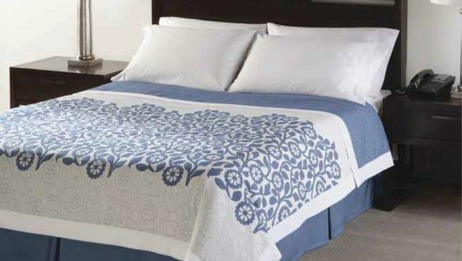 Sunrise Floral lightweight coverlet from Snowhite Textile and Furnishing, Inc.is one of the modern choices at the Days Inn.