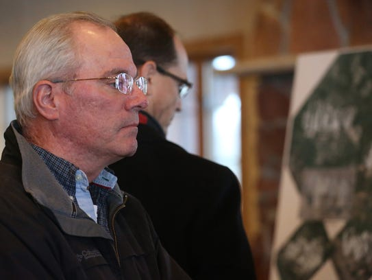 Tim Keefe, Wausau, checks out one of the drawings of
