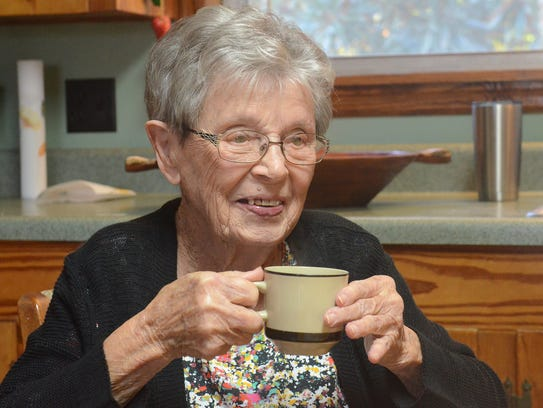Bertha Vickers sits at her kitchen table as she talks