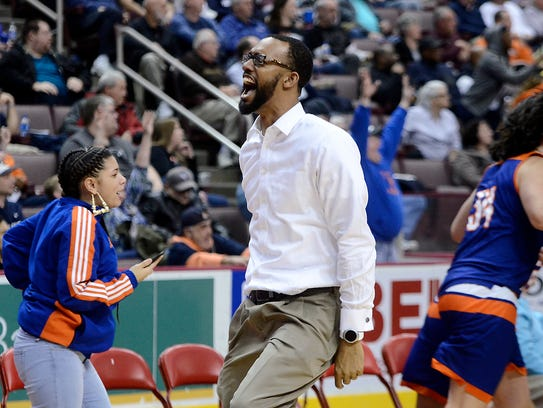 York High's Clovis Gallon celebrates during Monday's 84-80 overtime victory over Northeastern during the District 3 Class 5-A semifinals at Hershey's Giant Center. John A. Pavoncello