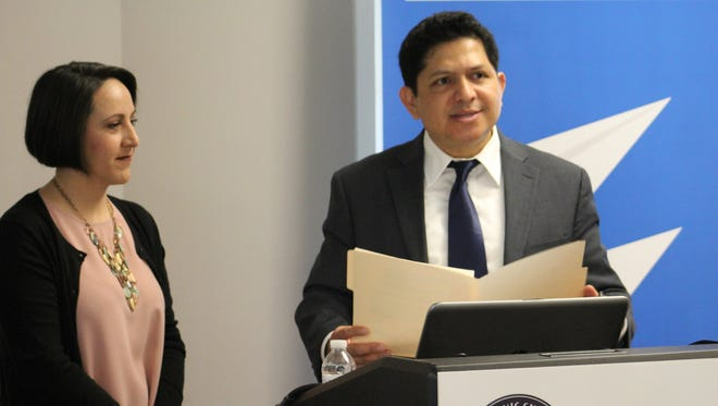Yuri Cunza, president and CEO of the Nashville Area Hispanic Chamber of Commerce, speaks as part of the group's 18th annual membership event as Claudia Herrera, office manager at Williamson, Inc., looks on Wednesday, March 22, 2017.
