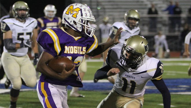 Munday's Trevaul Mitchell turns upfield around Perrin's Hunter Francis to score in the 2A Division II bi-district playoff Friday, Nov. 11, 2016, in City View.