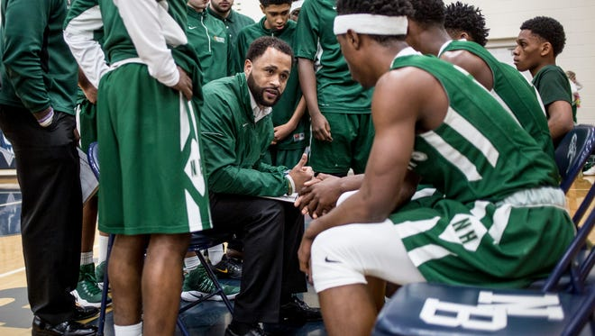 New Haven coach Tedaro France II talks with players on the bench during a regional final basketball game Wednesday, March 15, 2017 at North Branch High School. New Haven defeated Pontiac Notre Dame Prep 71-44.