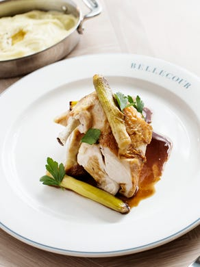 Beautiful French fare, like Poulet Roti, is served alongside a bar, chef's table, and adjacent bakery.