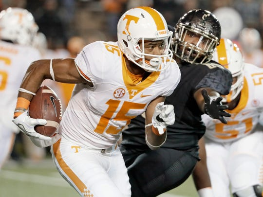 FILE - In this Nov. 26, 2016, file photo, Tennessee wide receiver Jauan Jennings (15) runs past Vanderbilt defensive lineman Adam Butler in an NCAA college football game in Nashville, Tenn. After one of its worst seasons ever, Tennessee should get a boost from the return of Jennings. (AP Photo/Mark Humphrey, File)