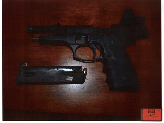 A firearm and clip from Todd Kohlhepp's home at 213