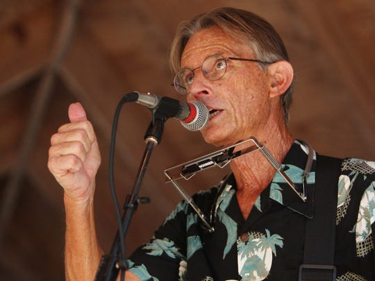 Singer/guitarist Bill McGuire, of Moondance, gives a thumbs up during his band's performance at Swamp Stomp at Tallahassee Museum in 2015McGuire has been involved with Gulf Winds Track Club from the beginning.