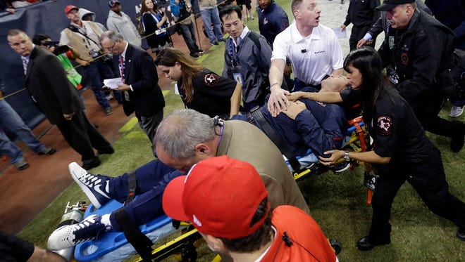 Houston Texans head coach Gary Kubiak is taken off the field on a stretcher during halftime of an NFL football game against the Indianapolis Colts.