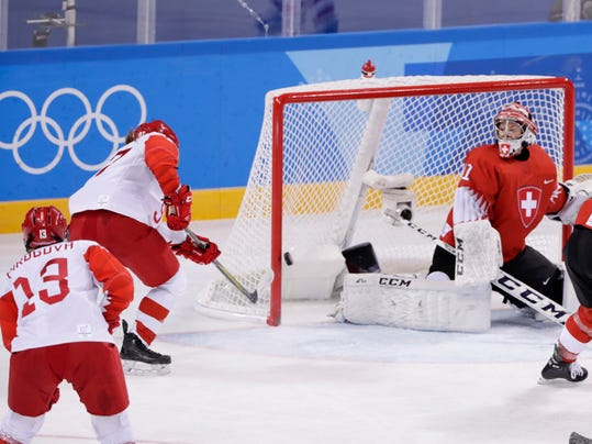 Goalie Florence Schelling (41), of Switzerland, watches as Russian athlete Anna Shokhina (97) shoots the puck past her for a goal during the third period of the quarterfinal round of the women's hockey game at the 2018 Winter Olympics in Gangneung, South Korea, Saturday, Feb. 17, 2018. The team from Russia won 6-2. (AP Photo/Frank Franklin II)