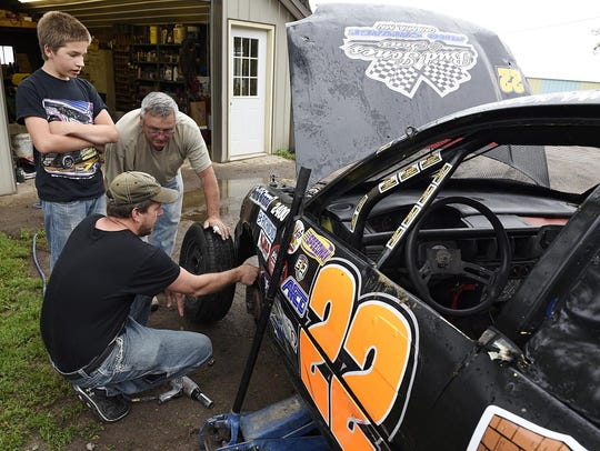 Brandon Yamry talks with his dad Cory (front) and Dale