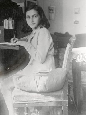 Anne Frank is writing in this April 1941 image released by the Anne Frank Foundation.