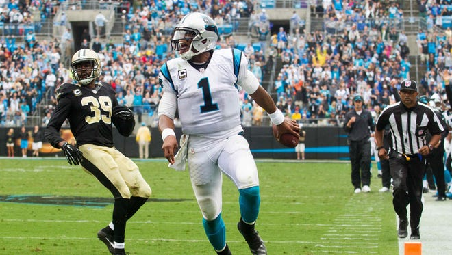 Carolina Panthers quarterback Cam Newton (1) runs in for a touchdown during the fourth quarter against the New Orleans Saints at Bank of America Stadium.