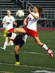 Franklin's Madison Kean elevates for a 50-50 ball during Thursday night's game.