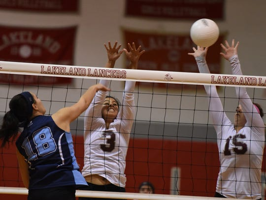 Clifton's Andrea Oyola-Mora (3) and Alison Moran (15) put up a block against Wayne Valley hitter Julie Beatty (18) in the Passaic County semifinals on Wednesday, Oct. 18.