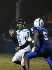 Quarterback, Jacob Winters, goes back for a pass during the game against LaRue Co.