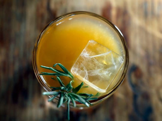 """Like a Shark"" includes Reposado tequila, grapefruit, lime, orange bitters, rosemary-smoked ice and other ingredients."