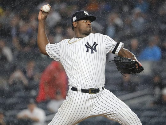 Luis Severino pitches in the first inning of Game 4