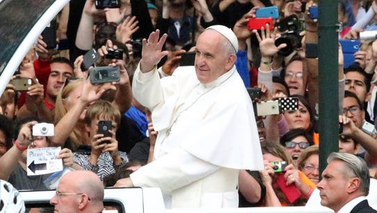 Pope Francis rides the popemobile into the Benjamin