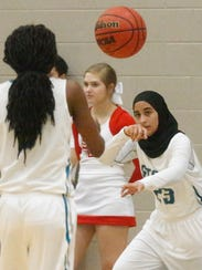 Siegel's Razan Haj-Hussein fires a pass to teammate Mia Metcalf during Monday's game against Stewarts Creek.