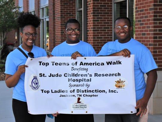 Jackson Top Teens Einiya Bell, Darrius Shaw and Charles