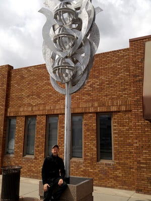 """David Sheldon with his sculpture """"Alpha Centauri,"""" after its installation in Greeley, Colorado."""