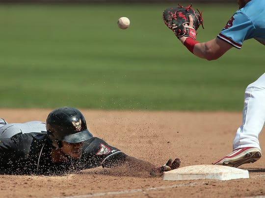 Patrick Wisdom (right) tries to make a tag on a runback during the Redbirds game against the Chihuahuas at Autozone park Thursday afternoon. A walk-off 2-run homer in the bottom of the 11th inning delivered Memphis a 2-0 win over El Paso in Game 2 of the Pacific Coast League championship series.