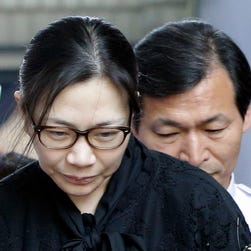Former Korean Air executive Cho Hyun-ah, center, leaves the Seoul High Court in Seoul, South Korea, Friday, May 22, 2015.