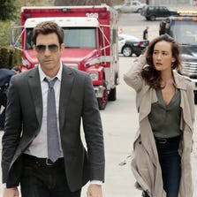 "This image released by CBS shows Dylan McDermott, left, and Maggie Q in psychological thriller ""Stalker,"" premiering Oct. 1. (AP Photo/CBS, Richard Cartwright)"