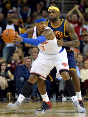 Knicks forward Carmelo Anthony posts up on Cavaliers forward LeBron James during Thursday's victory.