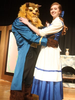 "Danny Andrews (left, as the Beast) and Alannah Walker (Belle, the beautiful princess) dance during a key scene in ""Beauty and the Beast,"" to be presented at 7 p.m. Friday and Saturday, March 23-24, at HLV High School, Victor."