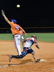 Lonnie Gaudet is safe at first base during the game.