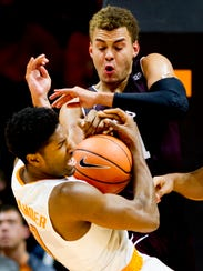 Tennessee forward Kyle Alexander (11) is knocked down