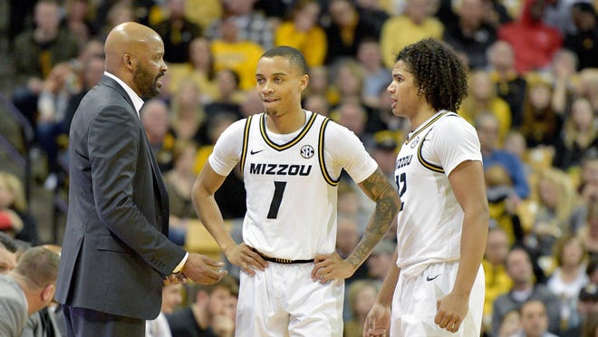 Missouri head men's basketball coach Cuonzo Martin talks with guards Xavier Pinson (1) and Dru Smith (12) in a timeout during a Southeastern Conference game against Auburn on Feb. 15 at Mizzou Arena.