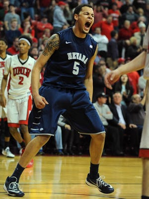 Wolf Pack forward Kaileb Rodriguez (5) celebrates after his team scored a 3-point basket near the end of a game against UNLV on Wednesday.