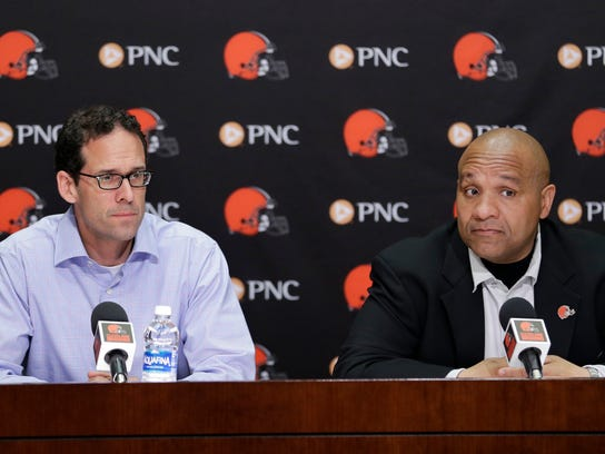 FILE - In this April 30, 2016, file photo, Cleveland Browns head coach Hue Jackson, right, and chief strategy officer Paul DePodesta listen to a question during a news conference at the NFL football team's training camp facility in Berea, Ohio. For the second straight year they've reached the midway point of the season at 0-8. They're now 1-23 under coach Hue Jackson and an analytics-reliant front office, whose decision to tear a roster down to its foundation has proven not only to be a failure but foolish.  (AP Photo/Tony Dejak, File)