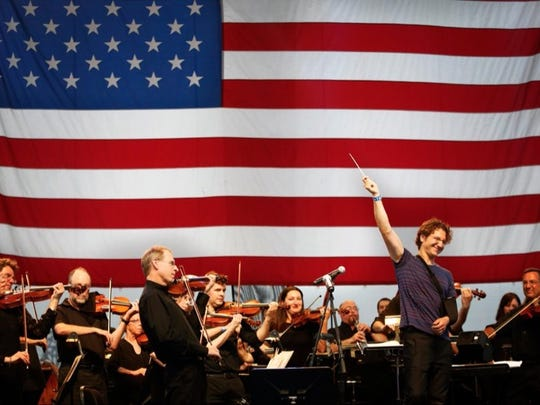 Teddy Abrams conducting the Louisville Orchestra at the 2015 Independence Day concert on the city's waterfront.