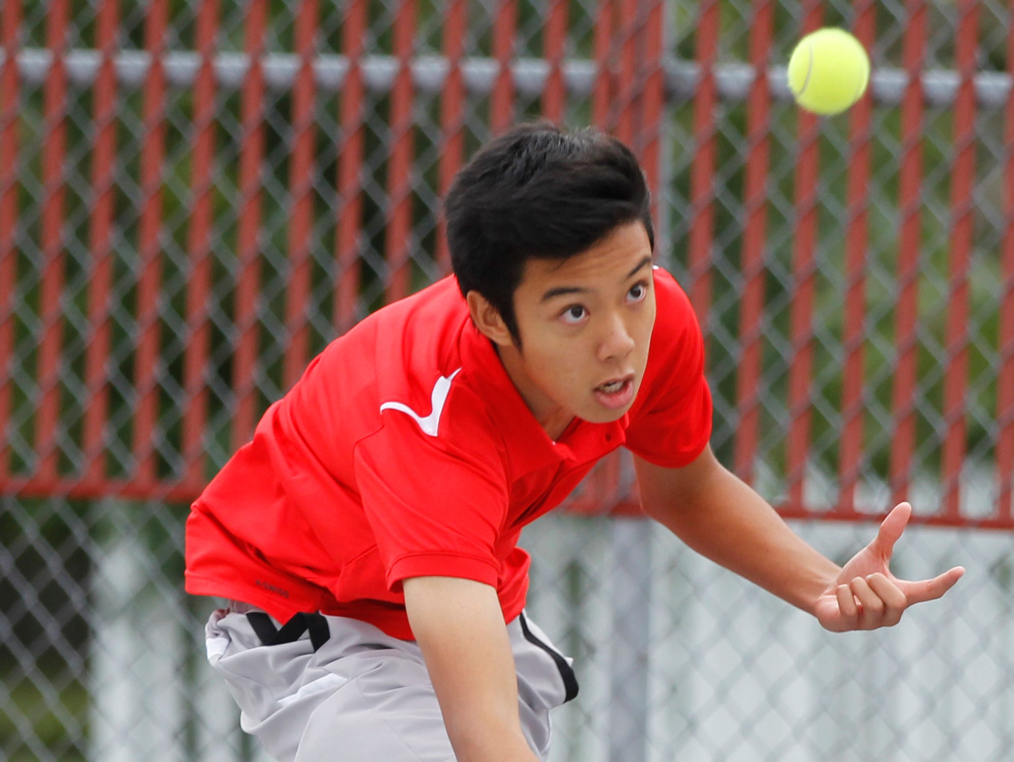 West Lafayette's Danial Watanabe with a return as he and teammate Jatin Sinahal take on Lafayette Jeff's Jacob Isbell and Danny Isbell at No. 2 doubles in the boys tennis sectional championship Friday, October 2, 2015, at Cumberland Courts in West Lafayette.