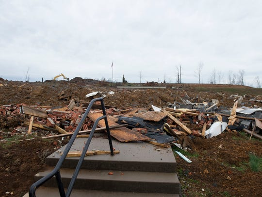 Debris litter the area at Fairview Baptist Church in Athens. A Nov. 30 tornado tore down the church's steeple but totally destroyed the old church auditorium, a two-story education building, the fellowship hall, and the gym.